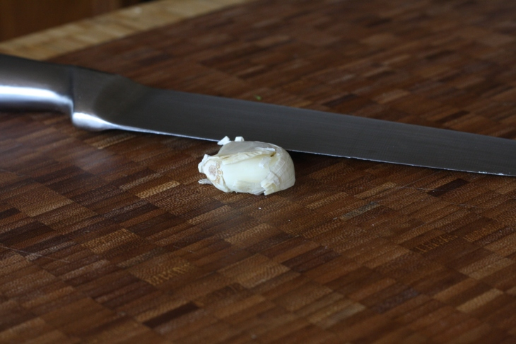 To easily remove garlic peel, lay your chef's knife flat down on the clove and (carefully) give it good whack with the heel of your hand.